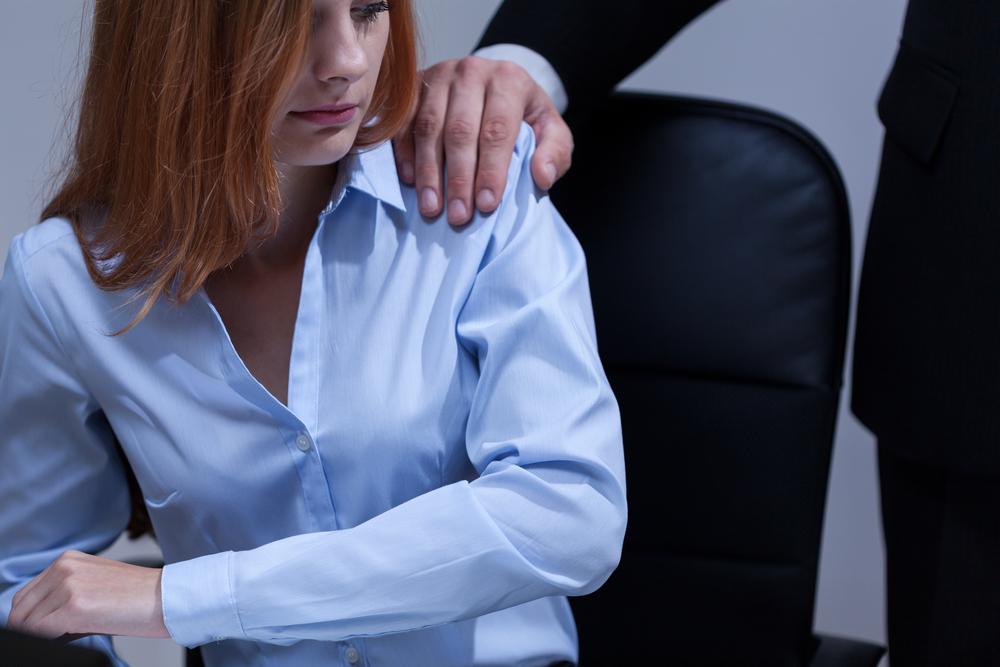 Hand on shoulder sexual harassment