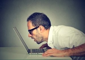 man gapes at laptop