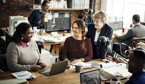 coworkers in an open plan office