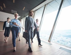 business people walking in a high rise