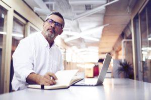older employee working at laptop