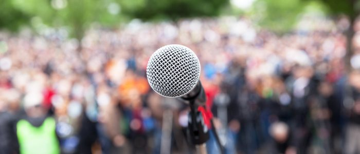 microphone in front of blurred crowd