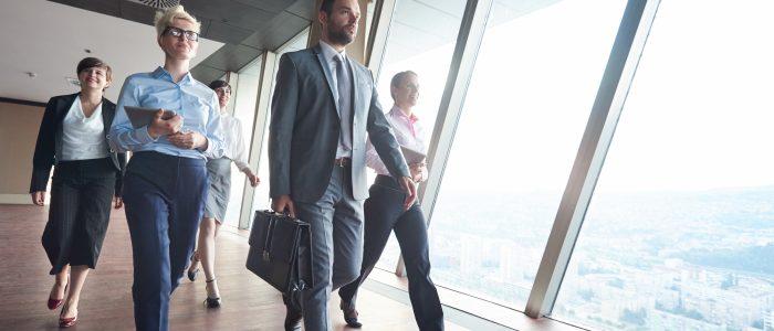 business people walking down hallway